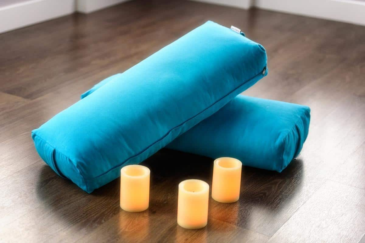 restorative yoga uses bolsters and pillows for support